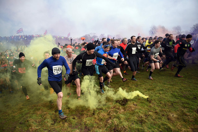 """Competitors start the """"Tough Guy"""" adventure race near Wolverhampton, central England, on January 29, 2017. (Photo by Oli Scarff/AFP Photo)"""