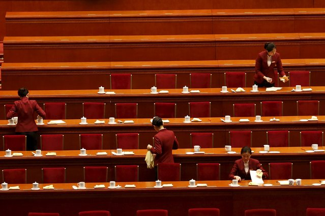Attendants clean after the third plenary session of the National People's Congress (NPC) at the Great Hall of the People, in Beijing, China, March 13, 2016. (Photo by Kim Kyung-hoon/Reuters)