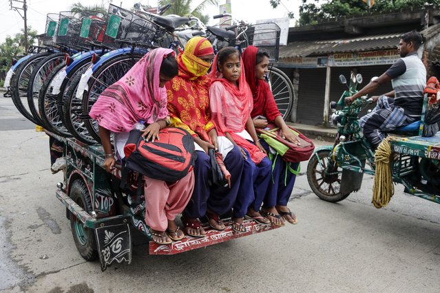 Girls ride an improvised motorbike public transport along with bicycles they received from their school under a government scheme in Malancha, South 24 Pargana district, India, Wednesday, October 20, 2021. (Photo by Bikas Das/AP Photo)