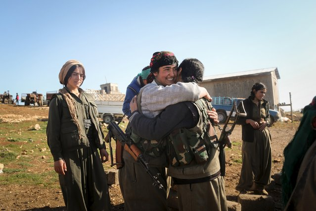 A Kurdistan Workers Party (PKK) fighters hugs her comrades as she leaves to go to another base in Sinjar, March 13, 2015. (Photo by Asmaa Waguih/Reuters)