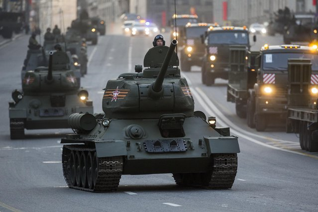 World War II era Soviet tanks T-34, front, and other military vehicles make their way to Red Square during a rehearsal for the Victory Day military parade which will take place at Moscow's Red Square on May 9 to celebrate 70 years after the victory in WWII, in Moscow, Russia, Monday, May 4, 2015. (Photo by Alexander Zemlianichenko/AP Photo)