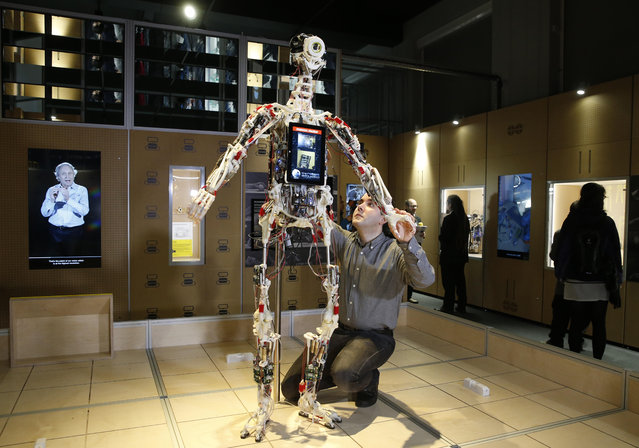 A technician adjusts Rob's Open Source Android (ROSAL) which was built in France from 2010-2016, during a press preview for the Robots exhibition held at the Science Museum in London, Tuesday, February 7, 2017. (Photo by Alastair Grant/AP Photo)