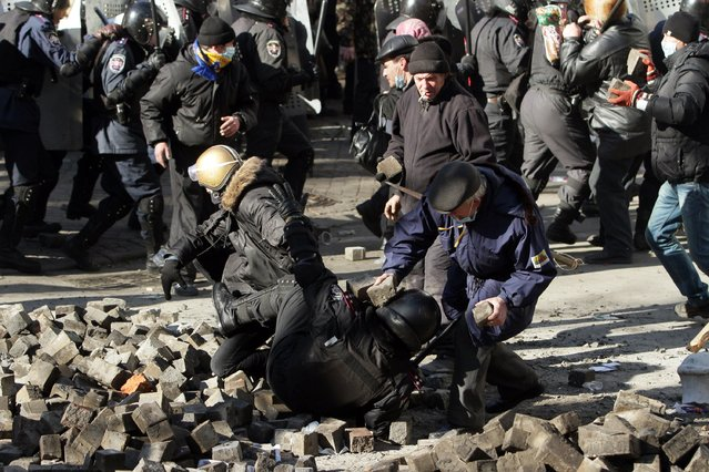 "Protesters clash with riot police in Kiev on February 18, 2014. Ukraine's prosecutor-general on Tuesday warned he would seek to impose the ""harshest punishment"" on those behind an outburst of violence in Kiev. ""The prosecutor-general will demand the harshest punishments for those who provoked people to carry out today's actions, those who organised it and those who directed it"", prosecutor-general Viktor Pshonka said in a statement. (Photo by Anatolii Boiko/AFP Photo)"