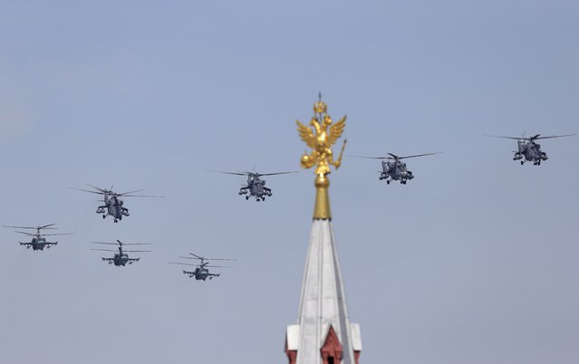 Russian Mil Mi-35 Hind helicopters fly in formation over the Red Square during the Victory Day parade in Moscow, Russia, May 9, 2015. (Photo by Reuters/Host Photo Agency/RIA Novosti)