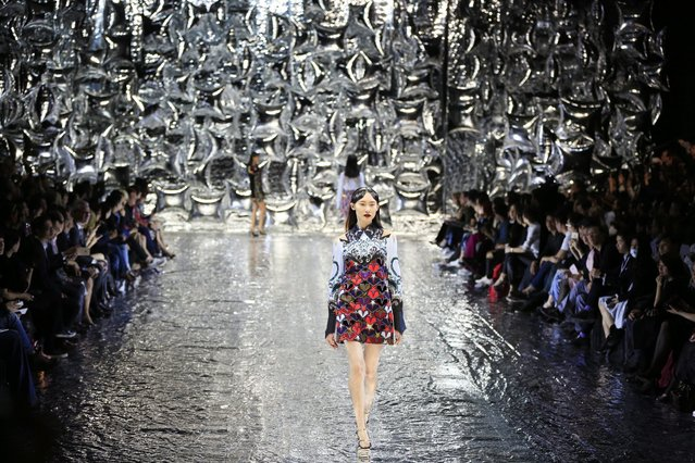 A model presents a creation by Greek designer Mary Katrantzou during the Mercedes-Benz China Fashion Week in Beijing, China, 27 March 2016. The fashion week runs until 31 March. (Photo by How Hwee Young/EPA)