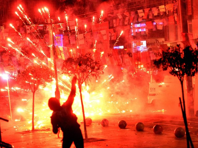 Fireworks thrown by protesters against Turkish riot police explodes and illuminates the scene during a demonstration in Istanbul. (Photo by Erdem Sahin/EPA)