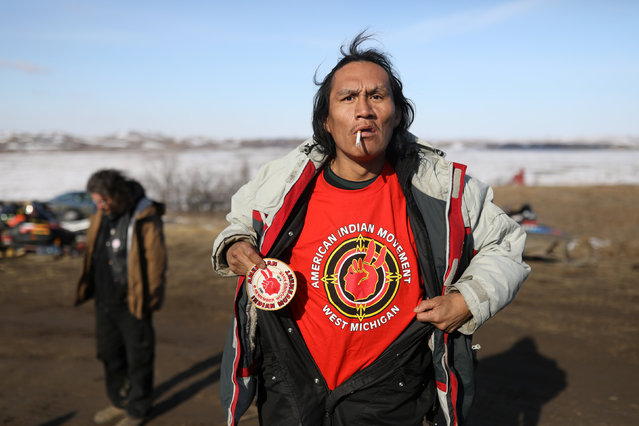 American Horse, of the Standing Rock Tribe displays an American Indian Movement shirt in Sacred Stone camp, one of the few remaining camps protesting the Dakota Access Pipeline in Cannon Ball, North Dakota, U.S., February 24, 2017. (Photo by Stephen Yang/Reuters)