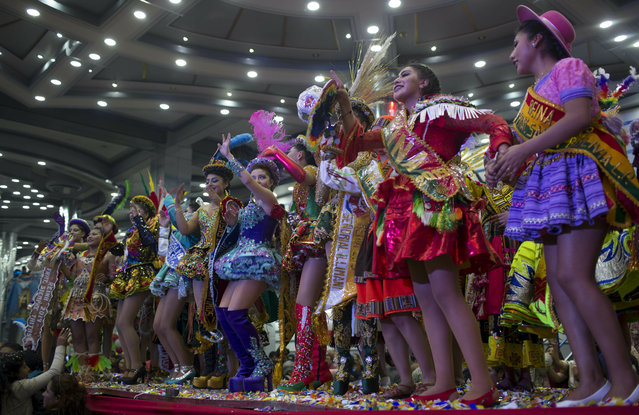 Contestants acknowledge the audience during the Queen of Great Power contest, in La Paz, Bolivia, Friday, May 24, 2019. (Photo by Juan Karita/AP Photo)