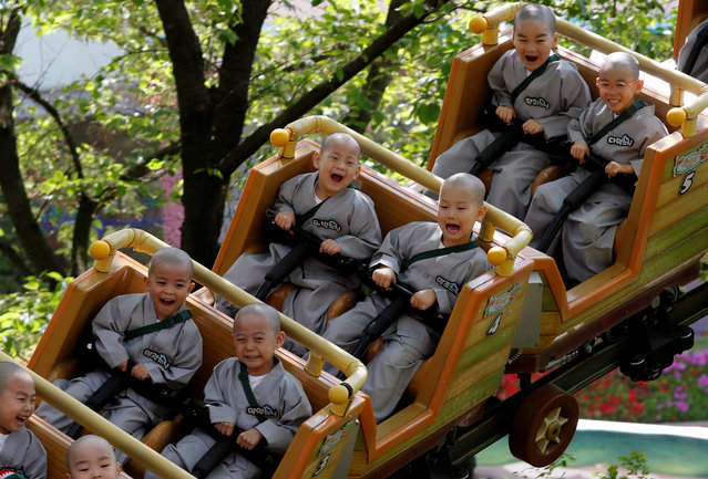 In this May 2, 2019, photo, Shaven-headed children ride a roller coaster during their visit at the Everland amusement park in Yongin, South Korea. Ten children entered a temple to have an experience of monks' life for three weeks. Buddhists visit a temple across the country to celebrate the Buddha's upcoming birthday on May 12. (Photo by Kim Hong-Ji/Reuters)