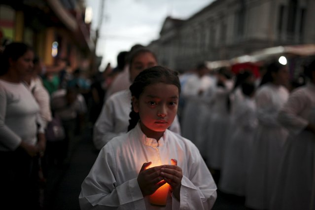 An altargirl participate in a procession for the late archbishop of San Salvador Oscar Arnulfo Romero during a procession in San Salvador May 22, 2015. (Photo by Jose Cabezas/Reuters)