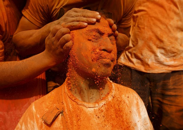 "A devotee is smeared with a vermillion powder while celebrating the ""Sindoor Jatra"" vermillion powder festival at Thimi, in Bhaktapur, Nepal, April 14, 2016. (Photo by Navesh Chitrakar/Reuters)"