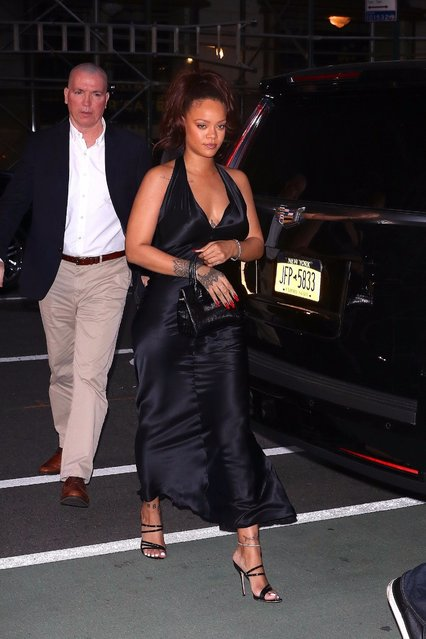 Rihanna looks happy in a s*xy black dress as she steps out for a private party in New York on June 11, 2019. (Photo by BlayzenPhotos/Backgrid)