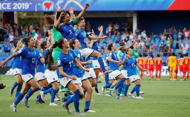 Italy's players celebrate at the end of the France 2019 Women's World Cup round of sixteen football match between Italy and China, on June 25, 2019, at La Mosson stadium in Montpellier, south western France.  Italy beat China 2-0. (Photo by Jean-Paul Pelissier/Reuters)