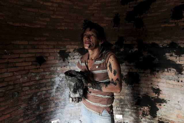 Maria prepares a furnace to make charcoal from wood at La Campanera village May 28, 2015. Around 300 families live off the sale of charcoal in this area located in the dry corridor of Nicaragua. Friday marks World Environment Day. Picture taken May 28, 2015. REUTERS/Oswaldo Rivas