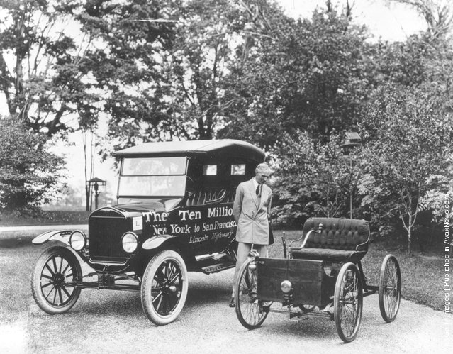 American motor vehicle industry pioneer Henry Ford (1863 - 1947) standing next to the first and the ten millionth Model-T Ford, 1924
