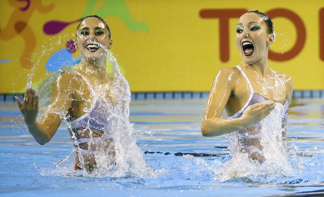 Luisa Borges and Maria Eduarda De Souza of Brazil perform during the synchronized swimming duet technical routine competition at the Pan Am Games Thursday, July 9, 2015, in Toronto. (Photo by Mark Humphrey/AP Photo)