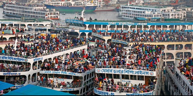 Bangladeshi homebound passengers gather on ferries as they travel to celebrate Eid with family in their villages, Sadarghat launch terminal in Dhaka, Bangladesh, 03 June 2019. Muslims around the world are preparing to celebrate Eid al-Fitr, the three-day festival marking the end of the Muslim holy month of Ramadan, Eid al-Fitr is one of the two major holidays in Islam. (Photo by Monirul Alam/EPA/EFE)