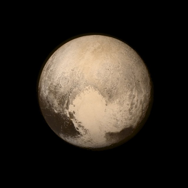 Pluto nearly fills the frame in this image from the Long Range Reconnaissance Imager (LORRI) aboard NASA's New Horizons spacecraft, taken on July 13, 2015, when the spacecraft was 476,000 miles (768,000 kilometers) from the surface and released on July 14, 2015. This is the last and most detailed image sent to Earth before the spacecraft's closest approach to Pluto on July 14. (Photo by Reuters/NASA/APL/SwRI)