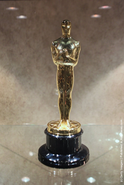 An Oscar statuette sits in a display case at R.S. Owens & Company