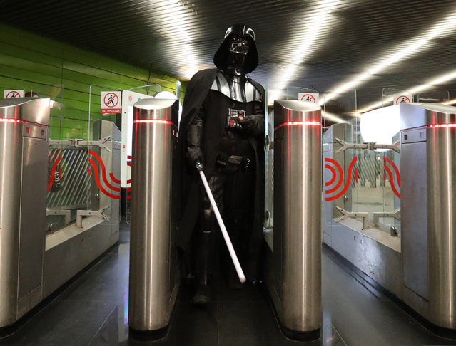 A man dressed as Darth Vader goes through the turnstile at Lermontovsky Prospekt station on the Moscow metro in Moscow, Russia on May 4, 2017. (Photo by Vyacheslav Prokofyev/TASS)