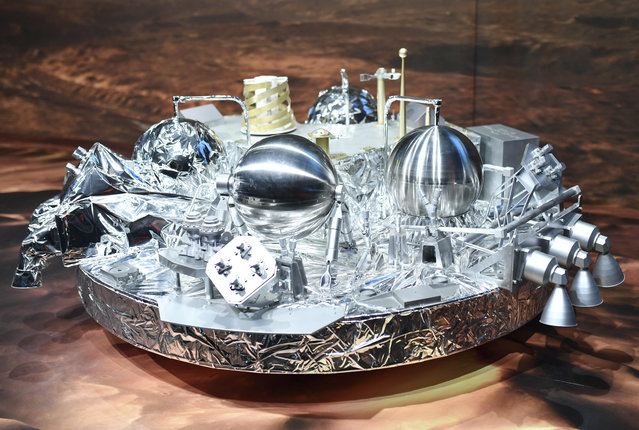 In this October 19, 2016 file photo, a model of Schiaparelli· the mars landing device , is on display at the European Space Agency, ESA, in Darmstadt, Germany.  An independent report on Wednesday May 24, 2017  concludes Europe's Schiaparelli probe crash-landed on Mars last year because its systems couldn't cope with a brief, wild rotation during its descent. (Photo by Uwe Anspach/DPA via AP Photo)