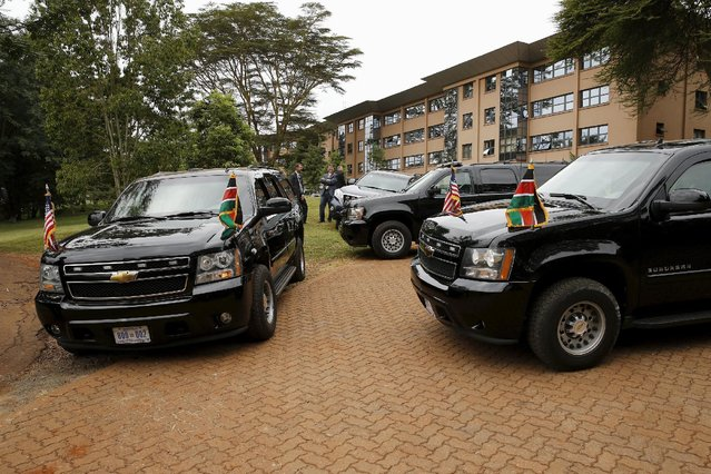 U.S. President Barack Obama's motorcade, with U.S. and Kenya flags affixed, sits outside as he delivers remarks at the Global Entrepreneurship Summit at the United Nations compound in Nairobi, Kenya July 25, 2015. (Photo by Jonathan Ernst/Reuters)