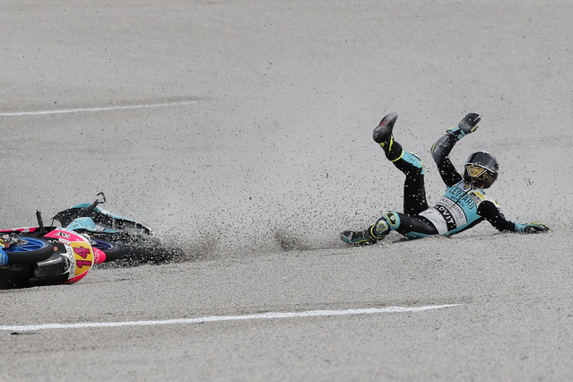 Moto3 rider Lorenzo Dalla Porta of Italy slides on the gravel after crashing during the Valencia Motorcycle Grand Prix, the last race of the season, at the Ricardo Tormo circuit in Cheste, near Valencia, Spain, Sunday, November 17, 2019. (Photo by Alberto Saiz/AP Photo)