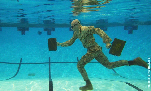 U.S. Marine Corps Lance Cpl. Reagan Lodge, Headquarters and Service Battalion, Marine Corps Base Quantico, conducts water running exercises during a phyiscal training session in Ramer Hall, The Basic School, on Marine Corps Base Quantico