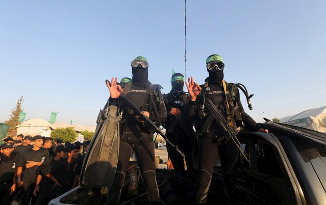 Palestinian members of the marine unit of al-Qassam Brigades, the armed wing of the Hamas movement, ride in a pick up truck during a military-style exercise at Liberation Youths summer camp, organised by the Hamas movement, in Rafah in the southern Gaza Strip, August 1, 2015. (Photo by Ibraheem Abu Mustafa/Reuters)