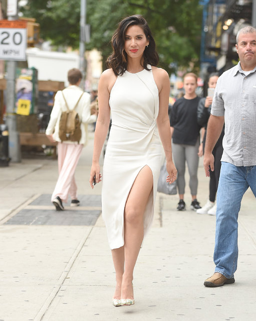 Olivia Munn seen wearing a cream dress in New York City, New York on June 16, 2017. (Photo by Robert O'neil/Splash News and Pictures)