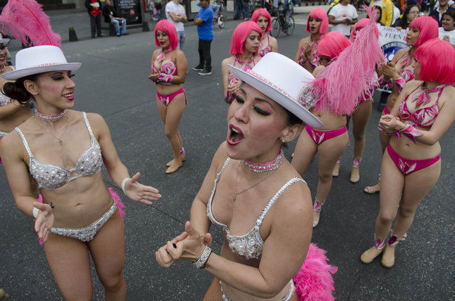 Karla Rosales, center, a performer in the Fuentes Gasca Brothers Circus, leads a chant during a protest against approved legislation that bans the use of animals in circuses, in Mexico City, Thursday, June 26, 2014. Circus performers fear that without their animals they will not survive because they believe people won�t want to come to only see the clowns, the acrobats and trapeze artists. (Photo by Sean Havey/AP Photo)