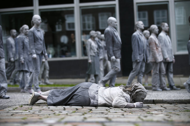 """Participants perform inthe so called """"1000 Figures"""" demonstration before the upcoming G20 summit in Hamburg, Germany, July 5, 2017. (Photo by Hannibal Hanschke/Reuters)"""