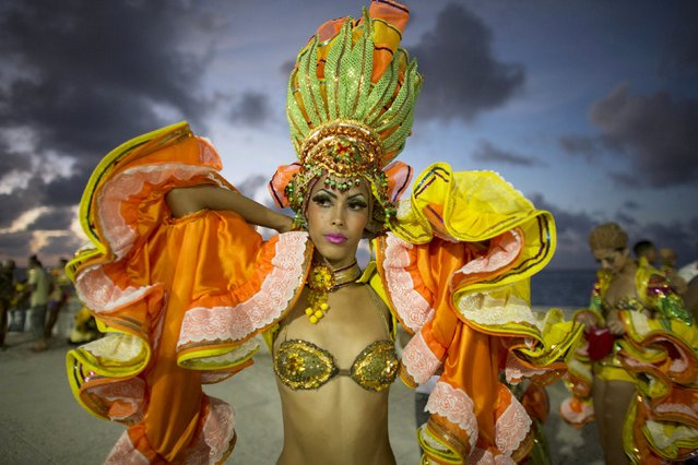 A reveler gets ready to perform at a carnival parade in Havana, Cuba August 7, 2015. (Photo by Alexandre Meneghini/Reuters)
