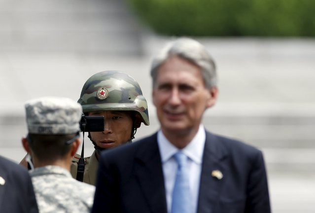 A North Korean soldier films as British Foreign Secretary Philip Hammond visits the truce village of Panmunjom in the demilitarised zone (DMZ) separating the two Koreas, South Korea, August 11, 2015. (Photo by Kim Hong-Ji/Reuters)