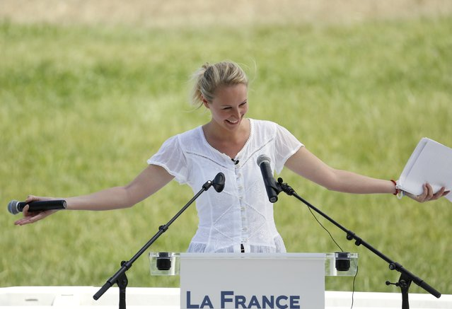 Marion Marechal Le Pen, deputy of Vaucluse, delivers a speech as she kicks off her National Front (FN) electoral campaign for the presidency of Provence-Alpes-Cote d'Azur Regional Council (PACA) in Le Pontet next to Avignon, France July 5, 2015. (Photo by Philippe Laurenson/Reuters)