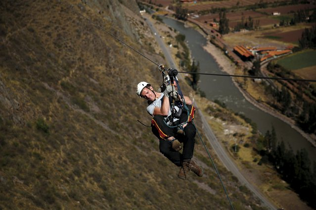 Guests rides a zipline as they leave the Skylodge Adventure Suites in the Sacred Valley in Cuzco, Peru, August 14, 2015. (Photo by Pilar Olivares/Reuters)