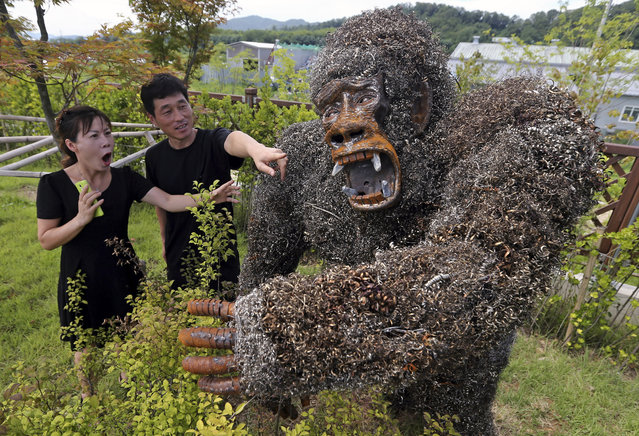 A sculpture of King Kong made from scrap iron, a prize-winning work at the 2014 Junk Art Contest, is displayed at a resource recycling center in southern Seoul, South Korea,  August 1, 2014. (Photo by EPA/Yonhap)