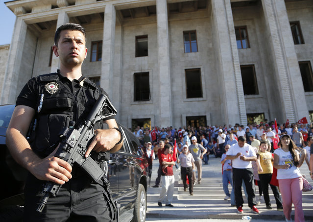 A Turkish special forces policeman stands guard outside Turkey's parliament near the Turkish military headquarters in Ankara, Turkey, Saturday, July 16, 2016. (Photo by Hussein Malla/AP Photo)