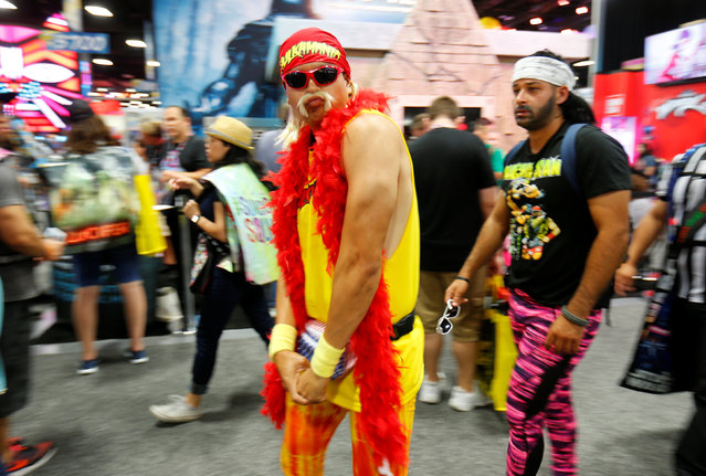 An attendee dressed as Hulk Hogan walks the convention floor during opening day Comic-Con International in San Diego, California, United States July 21, 2016. (Photo by Mike Blake/Reuters)