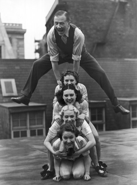 Jack Payne, the British dancer, pictured rehearsing with his troupe, 'Manhattan Six' on the roof of the Holborn Empire, 1938. (Photo by Fred Ramage)
