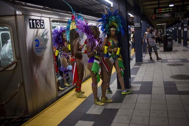 Participants walk out of a train as they arrive for the West Indian Day Parade in the Brooklyn borough of New York September 1, 2014. (Photo by Eric Thayer/Reuters)