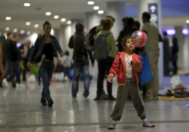 A migrant child plays with a ball at Keleti train station in Budapest, Hungary, September 5, 2015. (Photo by David W. Cerny/Reuters)