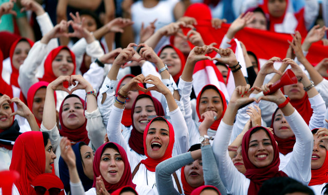 Egyptian fans celebrate after defeating Congo during the 2018 World Cup group E qualifying soccer match at the Borg El Arab Stadium in Alexandria, Egypt, Sunday, October 8, 2017. Egypt won 2-1. (Photo by Amr Abdallah Dalsh/Reuters)
