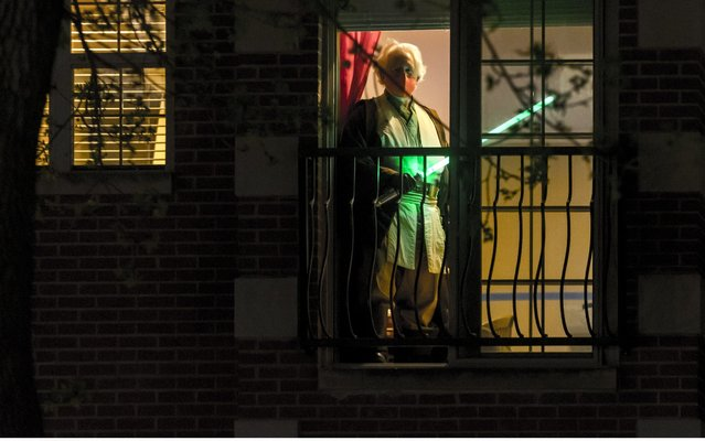 Jedi Ambassador of The Chicago Jedi, Dan McCann, 56, standing in his window in Chicago, Illinois on May 3, 2020. Normally, Dan would be preparing for The Galactic Battle For Chi-Town, a yearly mock Lightsaber battle in Chicago, which this year is being done via selfies shared over Facebook due to Illinois and Chicago's Stay At Home order. (Photo by Chris Riha/ZUMA Wire/Rex Features/Shutterstock)