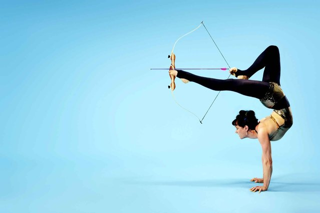 A recent undated handout picture released by the Guinness World Records on September 9, 2014, shows 26-year-old Nancy Siefker, who has made it into the 2015 Guinness World Records book for the Furthest Arrow Shot with the Feet. The circus artist from California, USA, is able to shoot an arrow 6.09m (20ft) onto a target measuring just 5.5 inches. (Photo by Ryan Schude/AFP Photo/Guinness World Records)