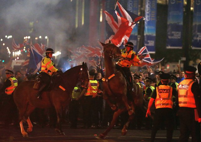 A police horse rears up as pro-union protestors clash with pro-independence protestors during a demonstration at George Square in Glasgow, Scotland September 19, 2014. Scotland spurned independence in a historic referendum on Thursday, saving a union dating back over 300 years but ushering in a period of intense bargaining over Britain's Prime Minister David Cameron's pre-vote pledges to give Scots more say over their own affairs. (Photo by Cathal McNaughton/Reuters)