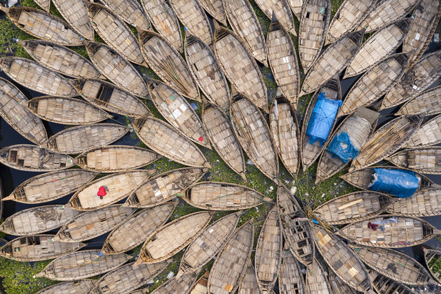 Aerial view of boats seen parked on the shores of the Buriganga river during a government-imposed lockdown as a preventive measure against the COVID-19 coronavirus in Dhaka, Bangladesh on April 03, 2020.(Photo by Zakir Hossain Chowdhury/Barcroft Media via Getty Images)