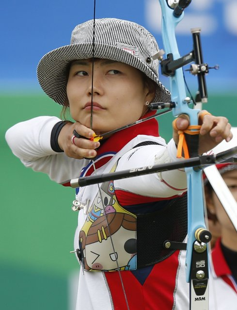 Japan's Ren Hayami aims during her recurve women's team semi-final archery match against China at the Gyeyang Asiad Archery Field during the 17th Asian Games in Incheon September 26, 2014. (Photo by Issei Kato/Reuters)