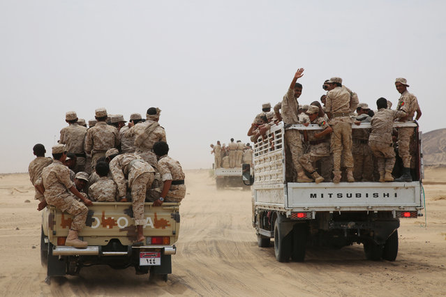 Yemeni army soldiers ride on trucks as they escort Yemen's Vice President Ali Muhssien al-Ahmar (not pictured) at a military barracks in the country's central province of Marib August 15, 2016. (Photo by Reuters/Stringer)