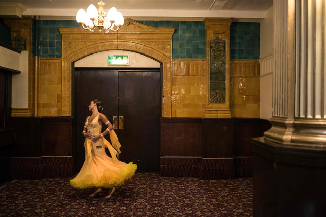 Ballroom dancers practice before competing in the British National Dance Championships in the Empress Ballroom of Blackpool' s Winter Gardens on November 16, 2017 in Blackpool, northern England. The three- day British National Dance Championships have been taking place since 1975 with couples competing in Ballroom and Latin dancing categories. (Photo by Oli Scarff/AFP Photo)
